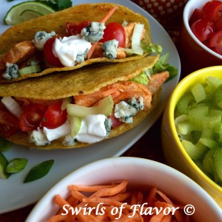Just let your imagination run wild and combine your favorite foods, tacos and buffalo chicken, and make Buffalo Chicken Tacos! Fill a taco with saucy spicy buffalo chicken topped with celery, carrots, tomatoes and creamy Roquefort blue cheese. buffalo chicken | tacos | taco Tuesday | cheese | buffalo sauce | dinner