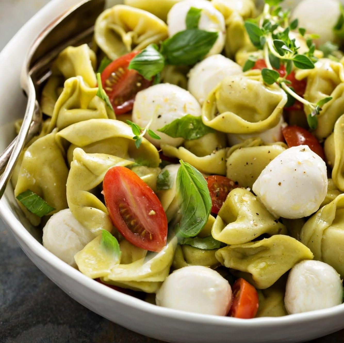 tortellini pasta salad ith tomatoes and fresh basil