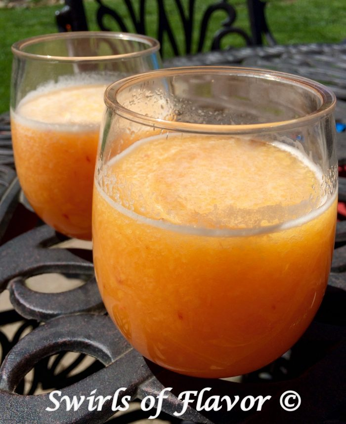 Say hello to the year of the wine slushy! Frozen peaches, Peach Schnapps and Prosecco whirl up into a fabulously delicious Peach Bellini Slushy! wine | wine slushy | prosecco | peach | bellini | frozen drinks