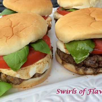 Caprese Burgers are seasoned with bits of sundried tomatoes and topped with melted fresh mozzarella, sliced tomato, fresh basil leaves and a balsamic drizzle! caprese | burgers | grilling | ground beef | tomsto | mozzarella | basil | balsamic vinegar