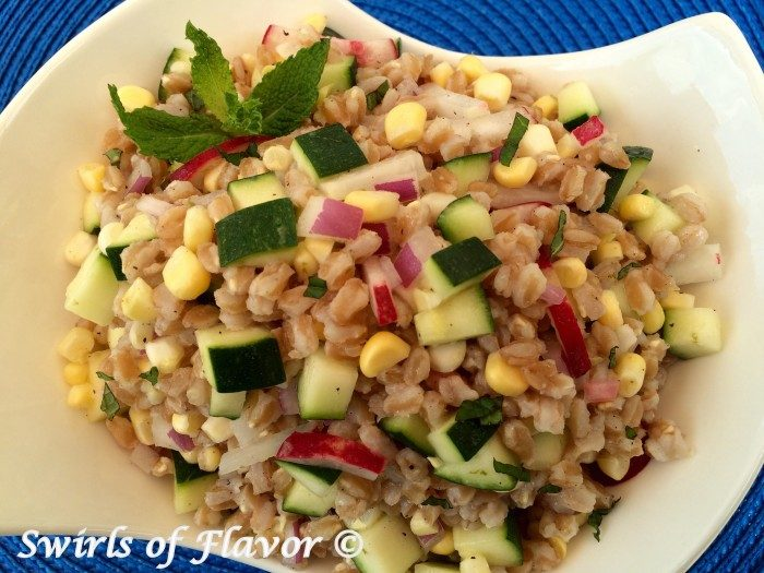 Fresh vegetables are tossed together with farro in a lime scented dressing making Zucchini & Corn Farro Salad a refreshing and nutritious easy summer side dish recipe. easy recipe   farro   farmers market   fresh vegetables   zucchini   corn on the cob   side dish   #swirlsofflavor