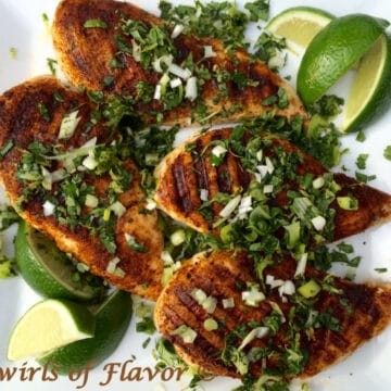 grilled spiced chicken with lime wedges