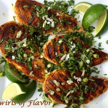 Grilled Chili Spiced Chicken With Cilantro Gremolata will quickly become your summer go-to recipe. Sprinkled over seasoned boneless chicken breasts, cilantro lime scented gremolata lends the perfect balance to the subtle heat of the spices. grilling | grilled chicken | boneless chicken breasts | lime | chili seasoning | gremolata | fresh herbs | #swirlsofflavor