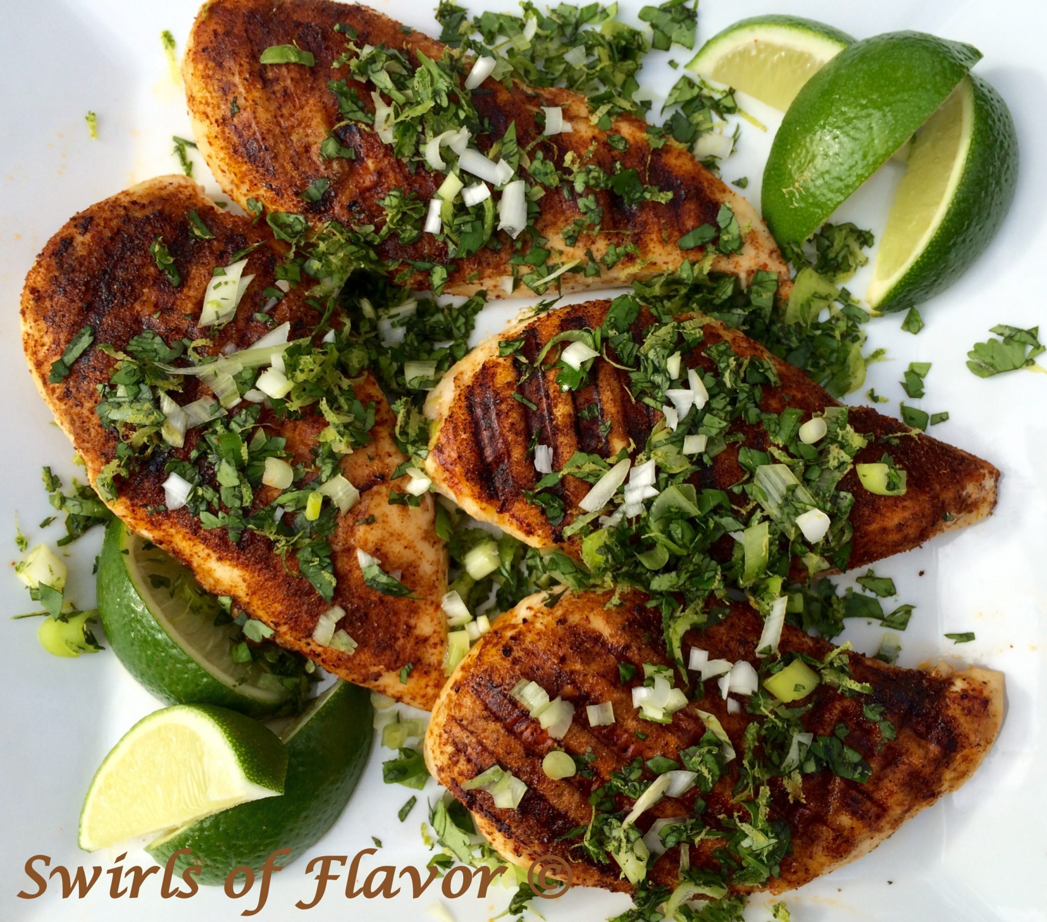 Grilled Spiced Chicken With Cilantro Gremolata and lime wedges