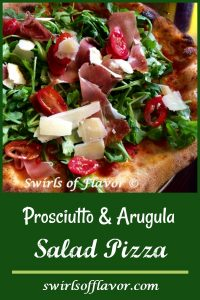 Grilled Prosciutto Parmesan & Arugula Salad Pizza is a homemade pizza grilled with sauce and cheese then topped with baby arugula tossed in a white balsamic vinaigrette with tomatoes and prosciutto.
