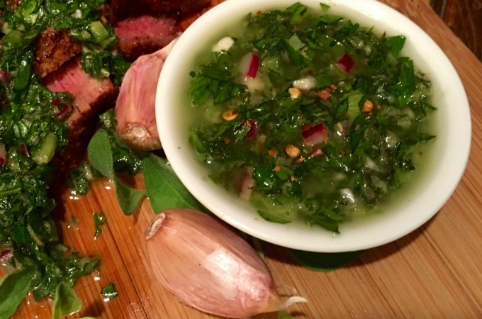 Quick and easy to make, Chimichurri Sauce is garlicky, herby, spicy and tangy all at the same time! Guaranteed to be your new fresh herb sauce of the summer! herbs | herb sauce | fresh herbs | Argentinean herb sauce | sauce for steaks