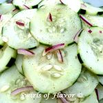 Cucumber Salad combines the crunch of fresh cucumbers with a light and tangy homemade vinaigrette and a hint of red onion making it the perfect side dish recipe on a warm summer evening.