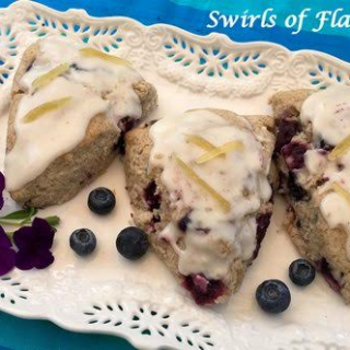 Ginger Glazed Blueberry Scones are the perfect way to savor the sweetness of juicy blueberry and tangy lemon together in an easy to make homemade sweet treat! Perfect for breakfast, brunch and even dessert!