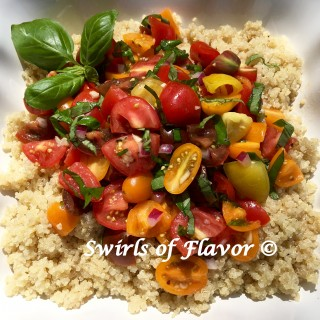 Heirloom Tomato Bruschetta Quinoa is an easy summer recipe with a bruschetta topping of heirloom tomatoes, red onion, fresh basil, olive oil and white balsamic vinegar and over a bowl of the super grain quinoa. easy recipe | side dish | summer | farmers market | heirloom tomatoes | quinoa | meatless Monday | entertaining | #swirlsofflavor