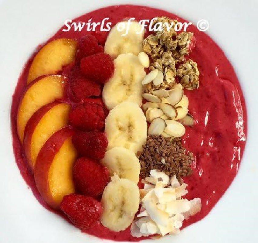 raspberry smoothie bowl with nectarie, banana and toppings