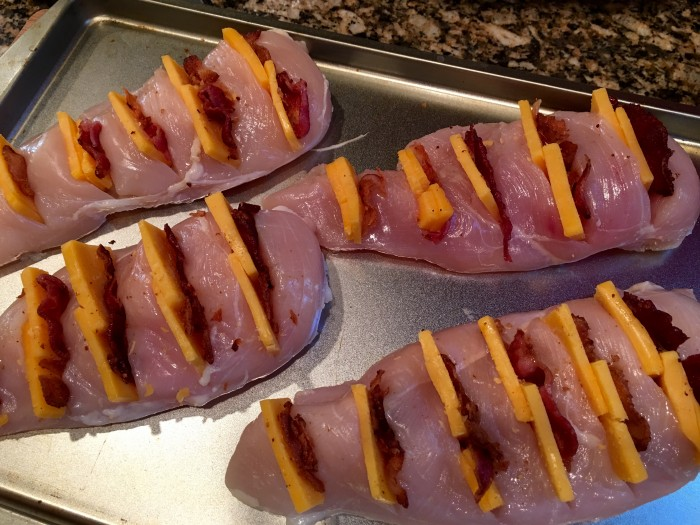 Step 3. Cheddar cheese and bacon arranged in pockets of chicken.