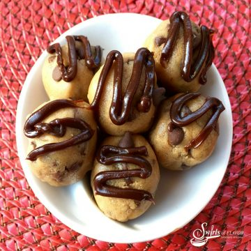 Bowl of no bake chocolate chip cookie bites with fudge drizzle