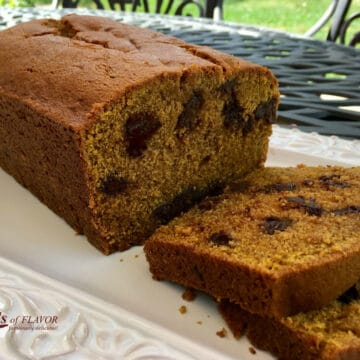 chocolate chip pumpkin bread with slices on white plate