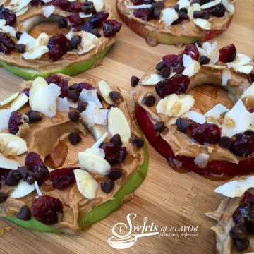 Peanut Butter Honey Apple Slices are an easy recipe for an after school snack. Apple slices are topped with peanut butter, cranberries, almonds and coconut and a cinnamon honey drizzle! #apple #apples #appleslices #funforkids #applesnacks #peanutbutter #coconut #honey #healthy #dessert #snack #swirlsofflavor