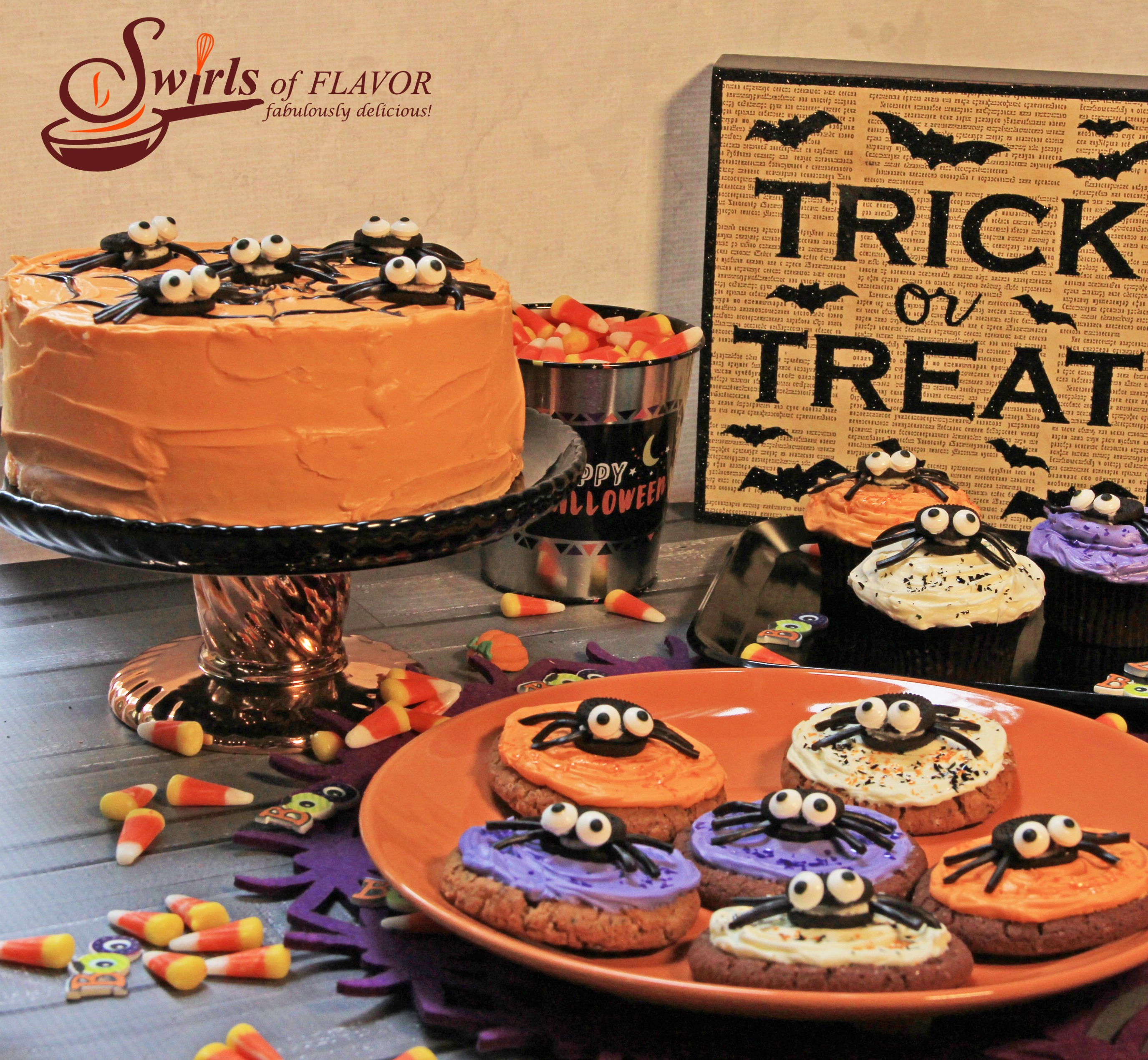 Spider cookies, spider cupcakes and spider cake with trick or treat sign