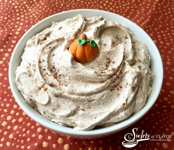 Everyone loves pumpkin pie spice and now you can have the perfect blend of warm fall spices in a creamy buttery frosting! Pumpkin Pie Spice Buttercream Frosting will be the crowing glory on your next cupcakes, cake, cookies, muffins or even pancakes! #pumpkinspice #pumpkinpiespice #buttercreamfrosting #frosting #easyrecipe #homemadefrosting #dessert #falldessert #homemadebuttercream #pumpkin #swirlsofflavor