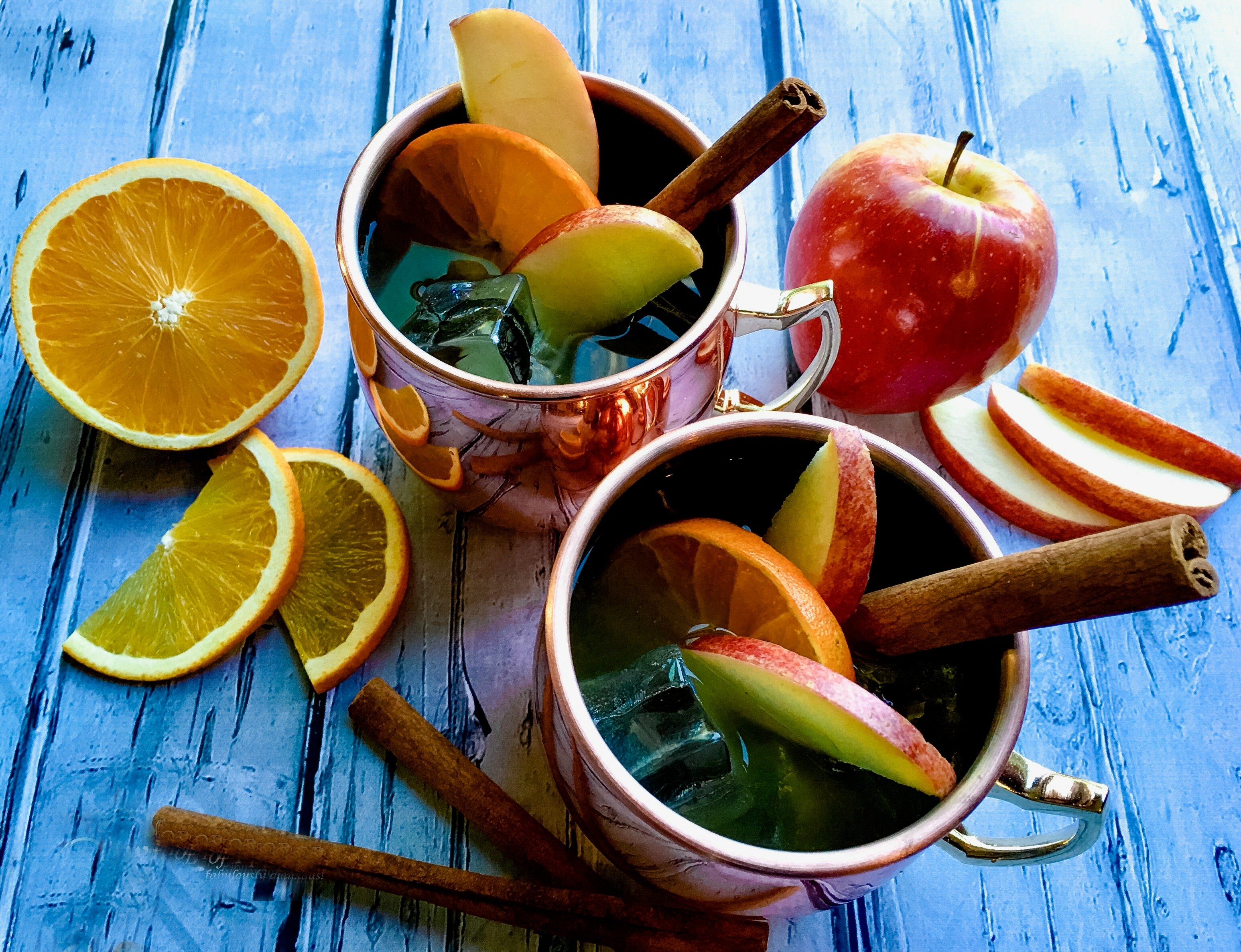 Apple Cider Moscow Mules with fruit