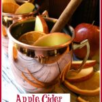 copper mugs with apple cider cocktail and text overlay