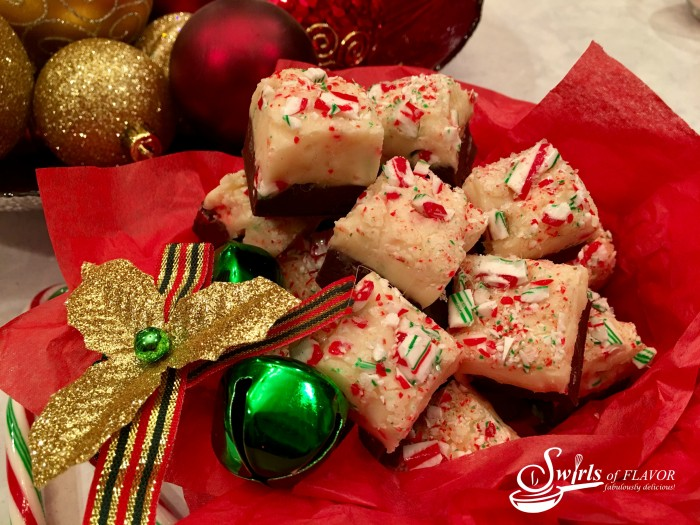 Candy Cane Fudge is the perfect holiday dessert for gift-giving and serving! A rich chocolate layer is topped with candy cane studded white chocolate making this an easy to make dessert and the perfect foodie gift! #fudge #homemade #homemadefudge #candycane #peppermint #easyrecipe #Christmas #foodgift #swirlsofflavor