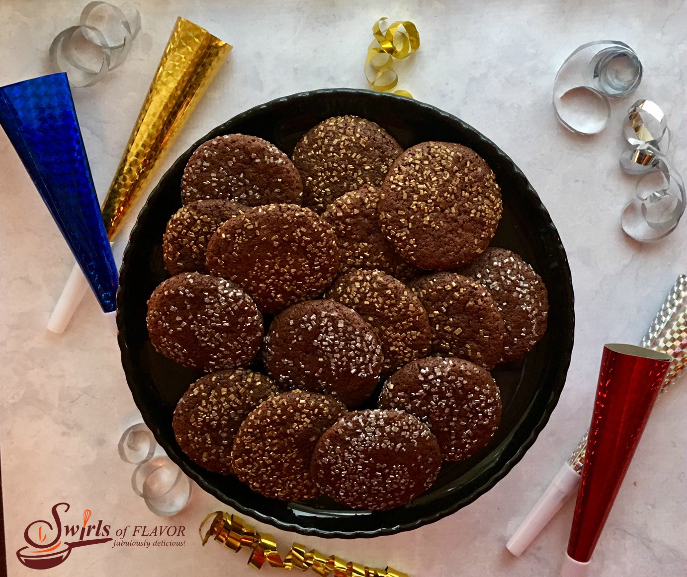 A simple chocolate cookie surrounded with twinkling sugars is easy to make and so impressive to serve as a holiday dessert. And we all know that glitter makes everything better!