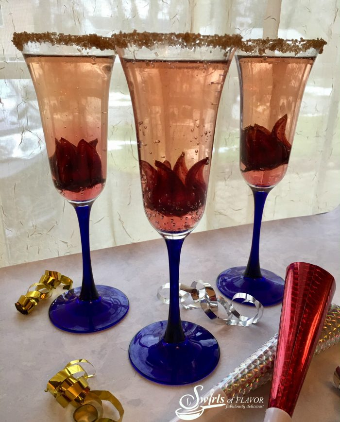 Welcome in 2017 with a dressed up sparkling cocktail! Edible wild hibiscus flowers unfurl as the bubbles in your glass fizz!
