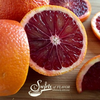 The blood orange, a member of the citrus family, is both beautiful in color and delicious in flavor. With it's raspberry-citrus notes and deep red color, the blood orange adds a refreshing flavor and brightens up recipes. Let's learn All About Blood Oranges! #allaboutbloodoranges #citrus #bloodorangenutrition #bloodorangebenefits #bloodorangerecipes #swirlsofflavor