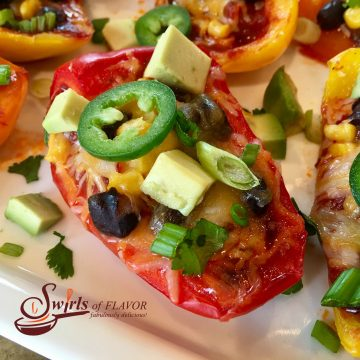 Spicy Nacho Stuffed Peppers is an easy appetizer recipe seasoned with taco seasoning and brimming with salsa, black beans, corn, avocado, jalapeno and cheesy goodness! #nachos #easyrecipe #appetizer #nachosrecipe #lowfat #glutenfree #cheese #stuffedpeppers #swirlsofflavor