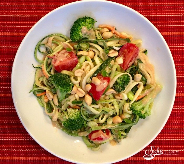 Zucchini Noodles & Broccoli With Peanut Sauce combine zucchini noodles with broccoli, cherry tomatoes, scallions and peanuts tossed in a silky peanut sauce for a fabulous vegetarian entrée.
