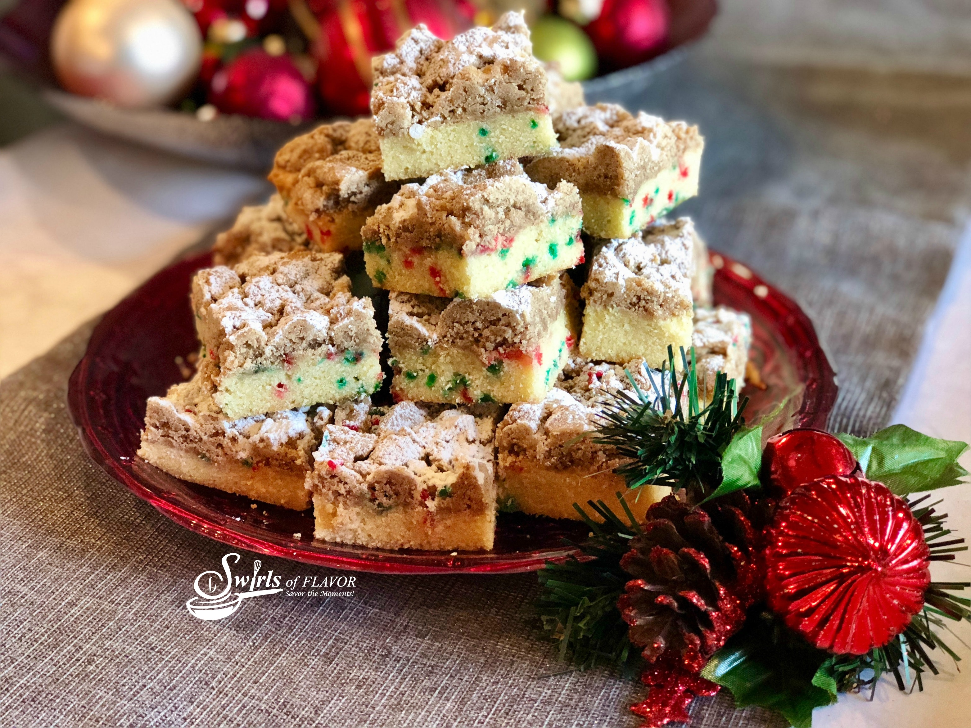Christmas Crumb Cake with holiday sprinkles and ornaments