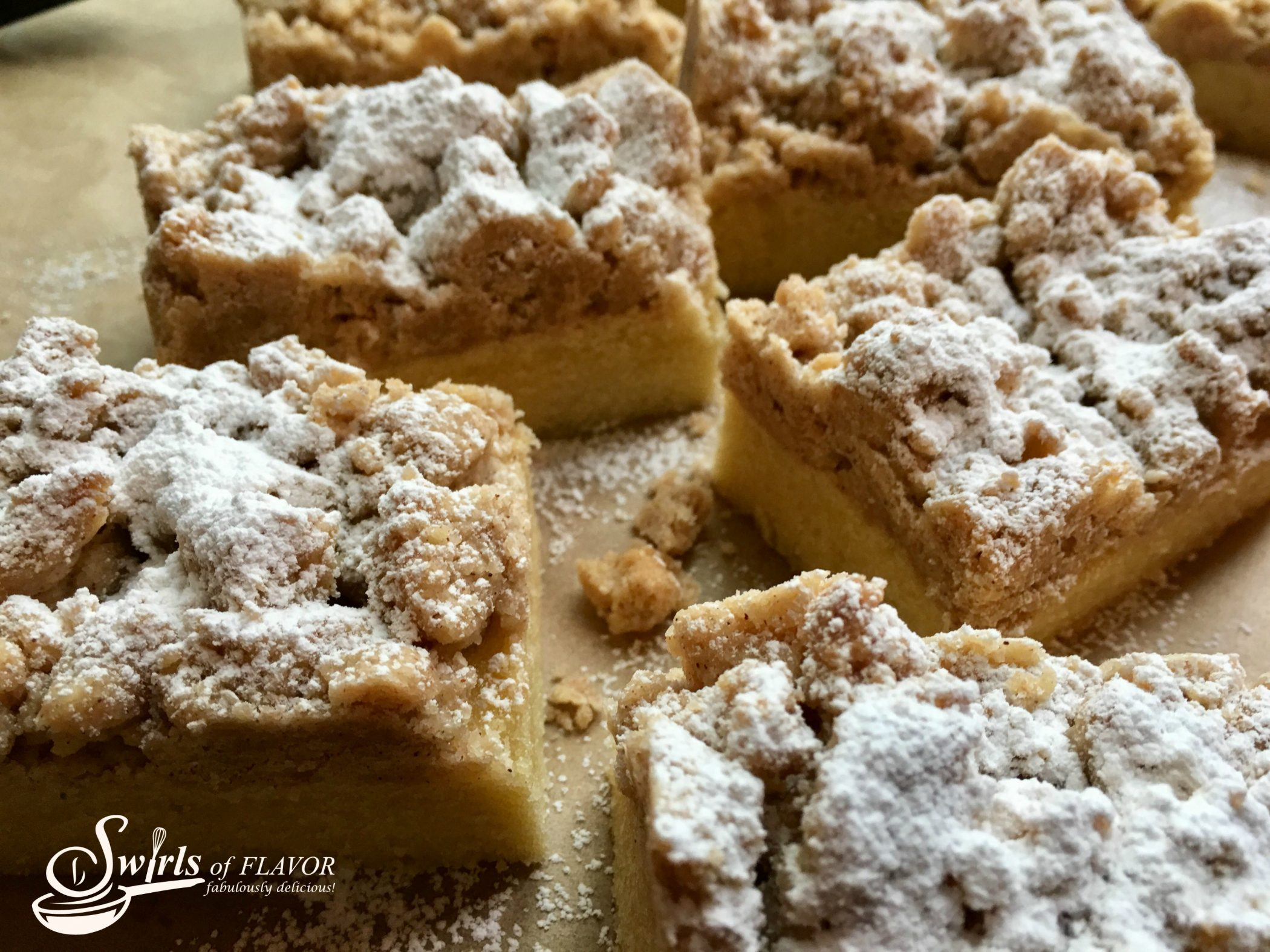 pieces of our crumb cake on parchment paper