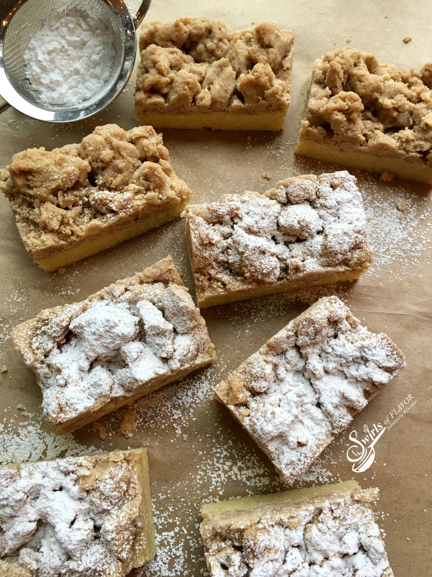 Crumb cake pieces with confectioners' sugar in sifter
