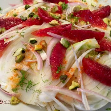 Pistachio Blood Orange & Fennel Salad is an easy salad recipe that's both refreshing and seasonal with citrus ingredients. Blood oranges flavor the citrus vinaigrette and are a bright addition to the pistachios and fennel salad. An easy recipe for a salad that can also be Whole30 with just one simple substitution. #salad #bloodorange #fennel #Whole30 #easyrecipe #saladrecipe #wintersalad #sidedish #swirlsofflavor