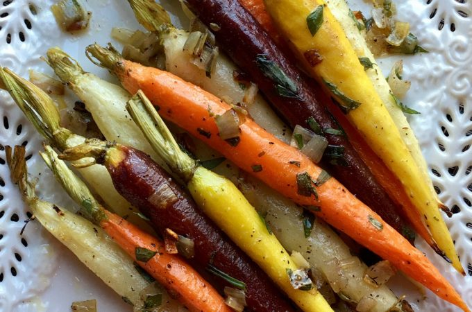 Roasted Tri-Colored Tarragon Carrots roastinto sweet tendernessin just twenty minutes. Finish with a tossof creamy butter and theperfect hint of freshanise flavor for abowlful of nutrition, beauty, elegance and heavenly flavor! carrots | roasted carrots | roasted vegetables | tri-colored carrots | tarragon | Easter | side dish | vegetable side dish