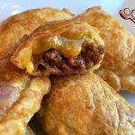 Cheeseburger Empanadas are an easy appetizer recipe bursting with a ground beef, ketchup and cheese filling. Every bite is filled with the flavors of a cheeseburger making Cheeseburger Empanadas the perfect kid friendly snack too!  #cheeseburger #funforkids #gamedayfood #empanadas #groundbeef #cheese #kidfriendly #snack #appetizer #CincodeMayo #easyrecipe #ovenbaked |#swirlsofflavor