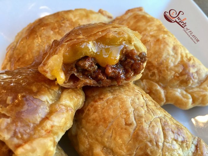 Cheeseburger Empanadas are bursting with a ground beef, ketchup and cheese filling, making them the perfect kid friendly snack!cheeseburger   empanadas   ground beef   cheese   kid friendly   snack   appetizer   Cinco de Mayo