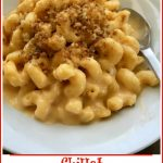 bowl of macaroni and cheese with spoon and text overlay