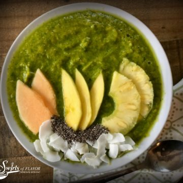 Tropical Turmeric Smoothie Bowl combines turmeric, greens and chia seeds along with fabulous tropical fruits for a healthy delicious smoothie bowl that's on trend! smoothie   smoothie bowl   chia seeds   turmeric   green smoothie   mango   pineapple   cantaloupe   breakfast   snack