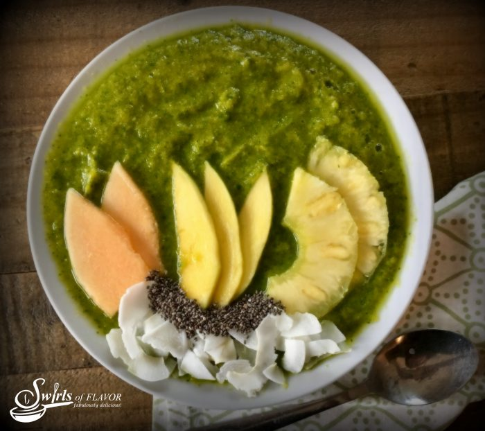 Tropical Turmeric Smoothie Bowl combines turmeric, greens and chia seeds along with fabulous tropical fruits for a healthy delicious smoothie bowl that's on trend! smoothie | smoothie bowl | chia seeds | turmeric | green smoothie | mango | pineapple | cantaloupe | breakfast | snack