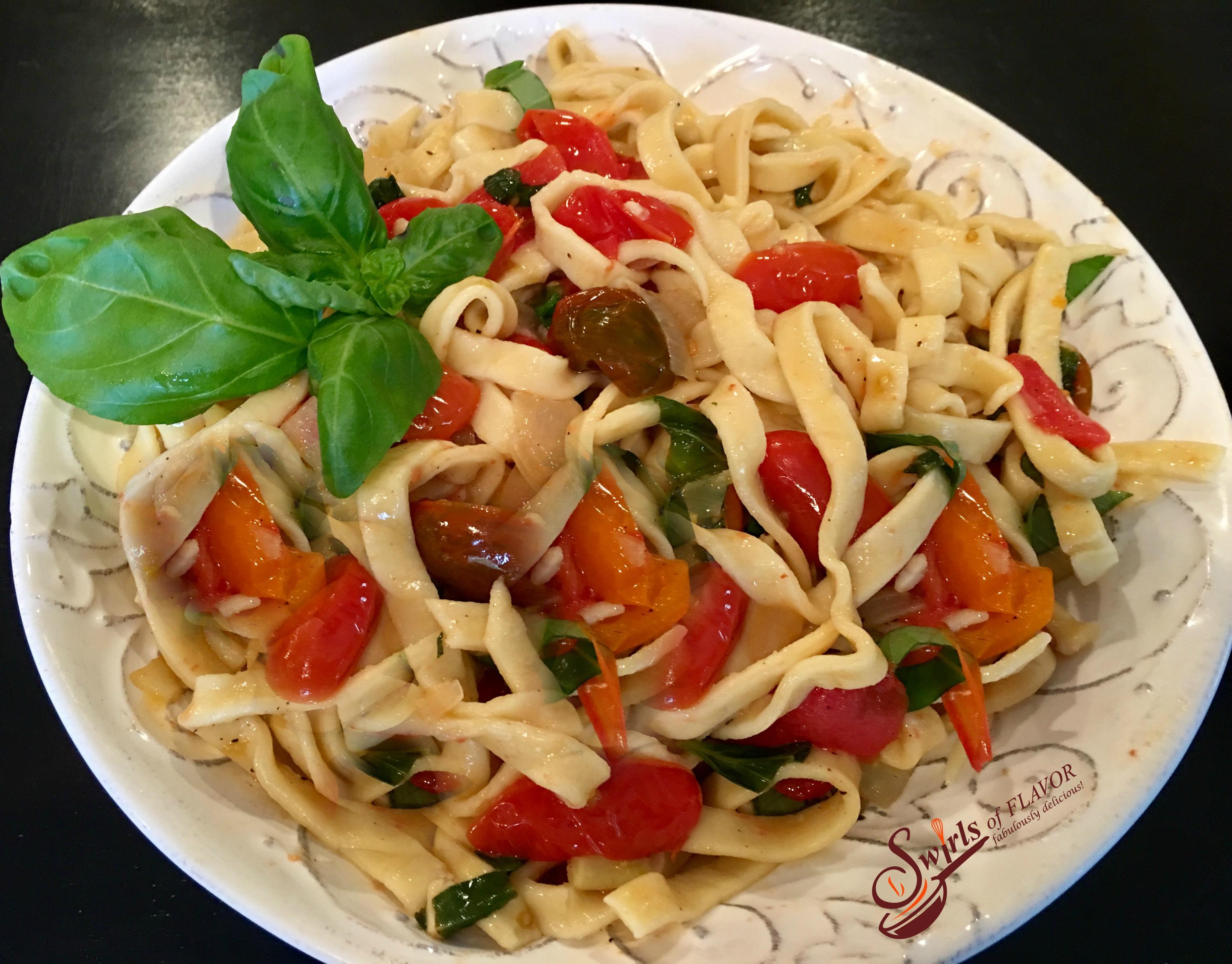 tomato basil pasta with fresh basil leaves