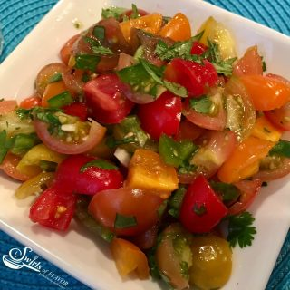 Fresh Heirloom Tomato Salsa is an easy homemade salsa recipe bursting with fresh summertime flavors and perfect with tortilla chips or tacos and over chicken, beef or fish! taco | fish | summer recipe | farmers market | heirloom tomatoes | easy recipe | salsa | Homemade | #swirlsofflavor