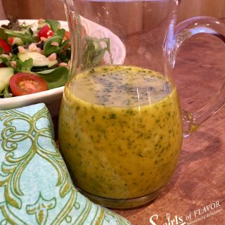 Turmeric Cilantro Vinaigrette is a homemade salad dressing that combines the flavors of the powerful and amazing turmeric along with cilantro and fresh ginger making it a fabulous vinaigrette that's perfect on salads, chicken, fish, vegetables and pasta. #turmeric #homemadevinaigrette #homemadesaladdressing #saladdressing #easyrecipe #salad #swirlsofflavor