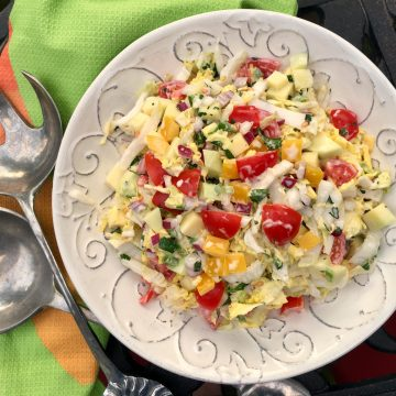 Mango Cole Slaw is alight creamy cole slaw with a tropical twist. Delicious as a side dish, on tacos, a burger or a sandwich! cole slaw | mango | mayonnaise | side dish | picnic | barbecue | potluck