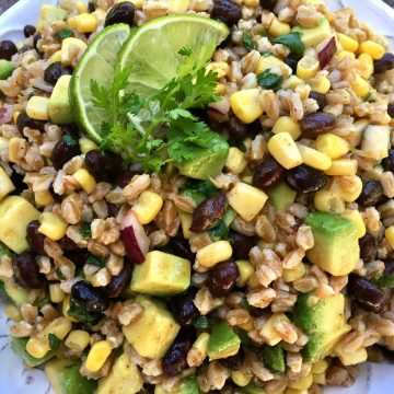 A chili lime vinaigrette, the creamy goodness of avocado, protein-rich black beans and fresh corn make Chili Lime Black Bean Corn Farro Salad the perfect addition to your alfresco table this summer! salad | avocado | black beans | corn on the cob | farro | grains