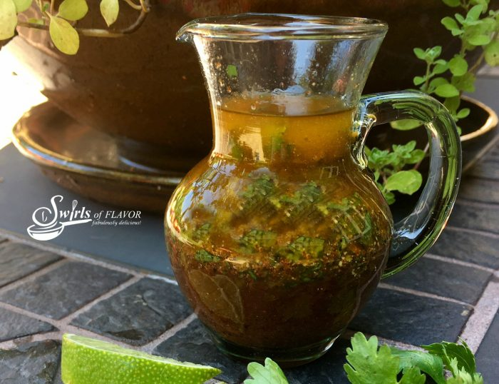 This homemade Chili Lime Vinaigrette will have your taste buds dancing as the fresh tangy flavor of lime combines with a hint of chili spice! #homemadesaladdressing #easyrecipe #vinaigrette #chilipowder #lime #cilantro #saladdressing #homemade #homemadevinaigrette #swirlsofflavor