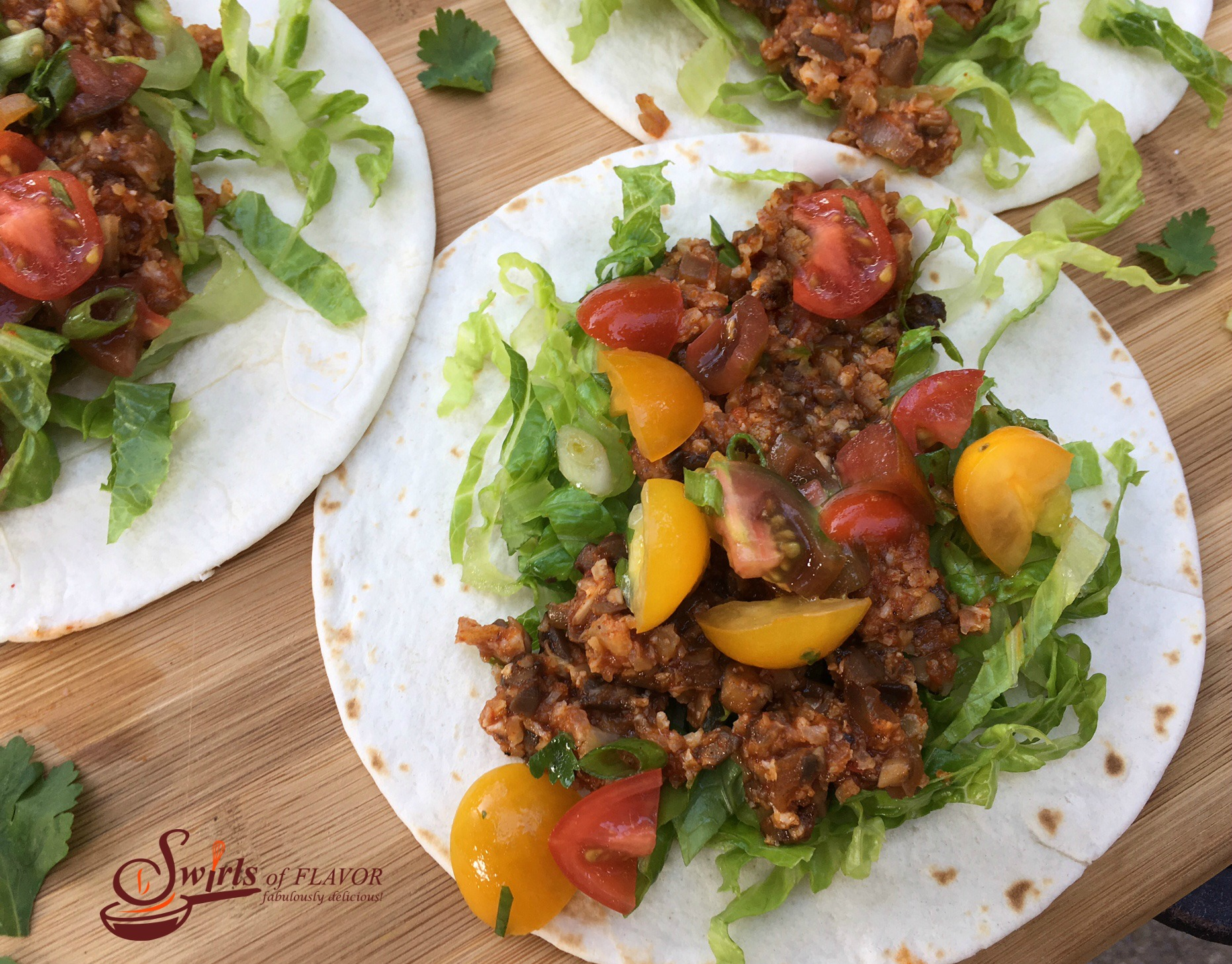 Cauliflower Tacos with shredded lettuce and chopped tomatoes