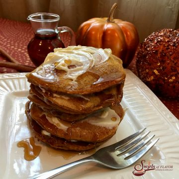 When National Pancake Day meets Pumpkin Spice season Pumpkin Spice Pancakes seasoned with pumpkin puree and pumpkin pie spice are born! Delicious for breakfast or for breakfast for dinner, Pumpkin Spice Pancakes are an easy recipe that's lightened with seltzer! #pancakes #seltzer #pumpkinpiespice #pumpkinpuree #breakfastfordinner #breakfast #easyrecipe #homemadepancakes #hotcakes #flapjacks #swirlsofflavor