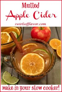 cup of warm apple cider with orange slices and text overlay