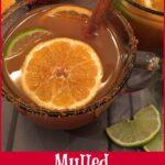 spiked apple cider drink with orange slice