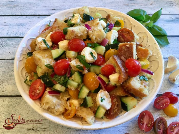Panzanella is the classic Tuscan bread salad bursting with heirloom tomatoes, cucumber, mozzarella and fresh basil! bread salad | summer | fresh produce | tomato salad | bread salad | easy recipe | #swirlsofflavor