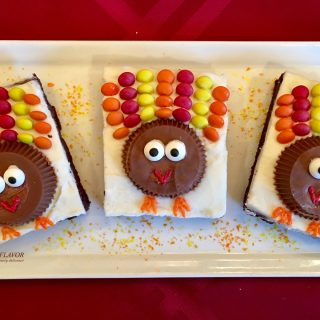 Turkey Brownies are an easy recipe for rich fudgy homemade brownies topped with a creamy vanilla buttercream and turkeys made of candy! So much fun to make and eat! Turkey Brownies are guaranteed to become a holiday tradition! #homemadebrownies #candyturkeys #turkeybrownies #dessert #easy recipe #funforkids #holiday #Thanksgiving #swirlsofflavor